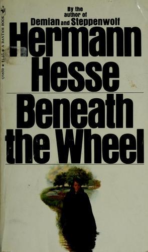Beneath the wheel.